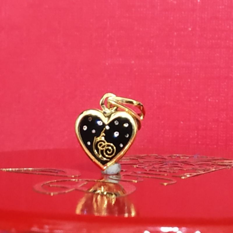 Love pendant in Katargam Jewellers Surat